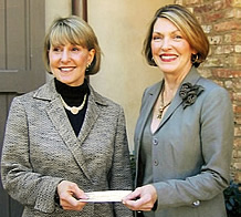 Katie Breese (left), chairman of The Oaks House Museum Corporation board from 2003 to 2006, is pictured accepting a check of more than $5,700 from Linda Lambeth, treasurer of the Garden Club of Jackson. The Garden Club of Jackson allocated the proceeds of its 2005 House and Garden Tour to fund landscape restoration work at The Oaks.